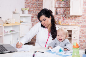 Mother and baby in home office